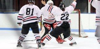 adult hockey players celebrating