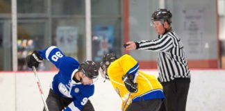 Hockey players with referee at face-off